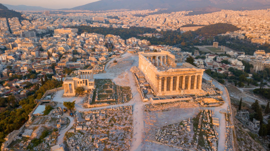 July 3, 2018, Athens, Greece: This is an aerial picture of the worldwide famous monument of the Acropolis.It was shot with a drone right before sunset. In the nearby Herodium theater a play was about to start that is why crowds can be seen there.