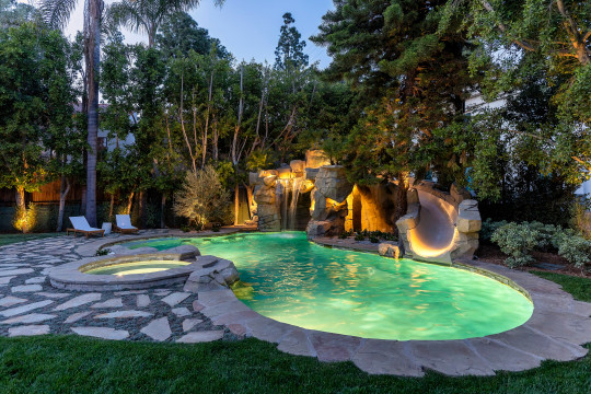 the pool and waterslide outside a beverly hills mansion for sale