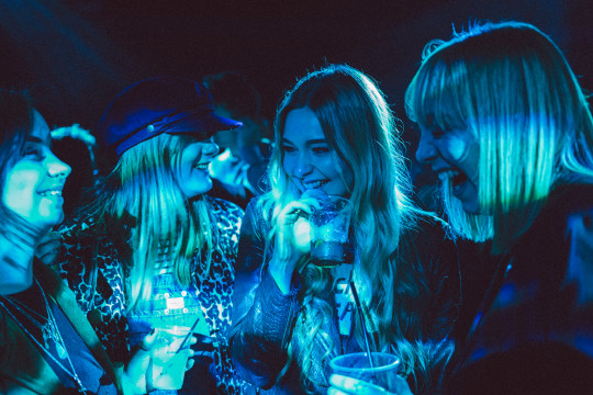women laughing in a club
