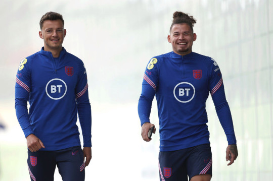 Ben White and Kalvin Phillips look on in England training