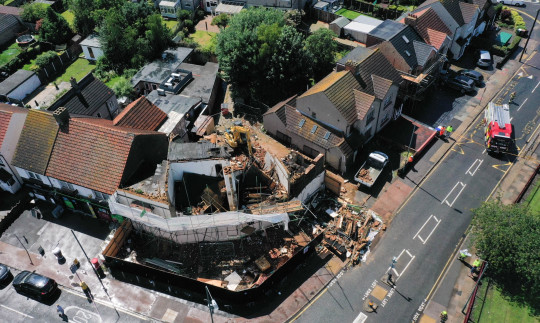 An aerial view of the collapsed building.  A workman had to be carried out from under a collapsed building in Welling, South East London, after it fell over during demolition.