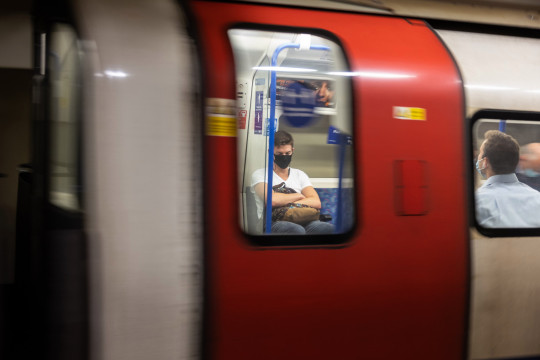 Commuters travel on the underground network during rush hour on July 06, 2021 in London, England.