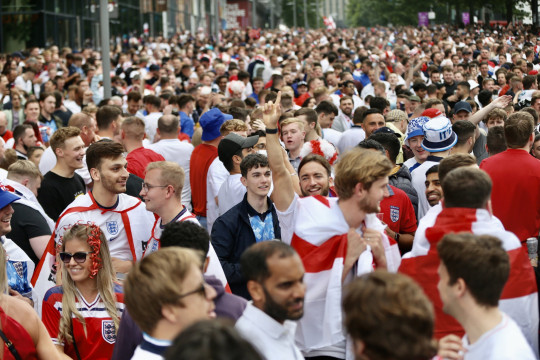 LONDON, UNITED KINGDOM - JULY 07: Fans cheer before entering the Wembley Stadium ahead of EURO 2020 semi-final football match between England and Denmark in London, United Kingdom on July 07, 2021. (Photo by Hasan Esen/Anadolu Agency via Getty Images)