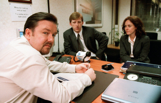 Television programme : The Office - Series 2...Picture Shows: David (Ricky Gervais) meets Ray & Jude about his management speech TX: BBC TWO MONDAY 14 OCTOBER 2002 Series Two of the BAFTA winning comedy, the painfully accurate portrait of the modern work-place that leaves you either counting your blessings or questioning your career. David Brent tries to assimilate the new Swindon intake, a group of well-trained and highly motivated personnel. It should be an easy job. Sadly, someone forgot to tell them they're meant to laugh at everything David says. Unlucky-in-love Tim finds his fortune changing, we discover there's more to demure Dawn than first meets the eye, but there's even less to Gareth. WARNING: This copyright image may be used only to publicise current BBC programmes or other BBC output. Any other use whatsoever without specific prior approval from the BBC may result in legal action....BBC TWO Unmanipulated picture MONDAY 14 OCTOBER 2002