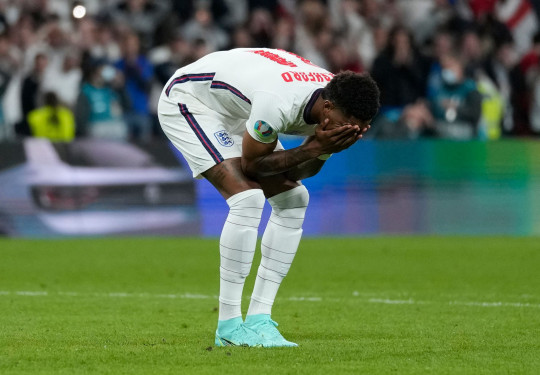 Soccer Football - Euro 2020 - Final - Italy v England - Wembley Stadium, London, Britain - July 11, 2021 England's Marcus Rashford looks dejected after missing a penalty during a penalty shootout Pool via REUTERS/Frank Augstein
