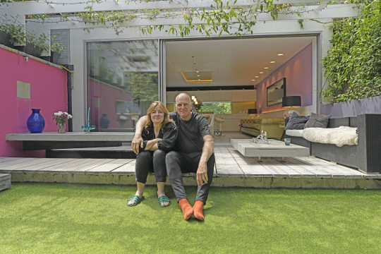 Hidden House. Picture shows homeowners Claire Farrow & architect Ian Hogarth photographed at their 'hidden' home they created on a disused gardens at the bottom of a Mews in Kensington, West London. Credit: Daniel Lynch 07941 594 556. www.lynchpix.co.uk