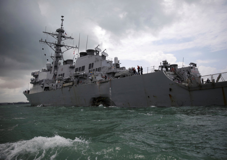 The U.S. Navy guided-missile destroyer USS John S. McCain is seen after a collision, in Singapore waters August 21, 2017. REUTERS/Ahmad Masood - RC12E55D1AE0