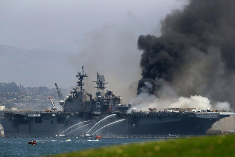 SAN DIEGO, CALIFORNIA - JULY 12: A fire burns on the amphibious assault ship USS Bonhomme Richard at Naval Base San Diego on July 12, 2020 in San Diego, California. There was an explosion on board the ship with multiple injuries reported. (Photo by Sean M. Haffey/Getty Images) *** BESTPIX *** 8518101 Federal fighters continue to battle blaze aboard USS Bonhomme Richard which 'could last for days'