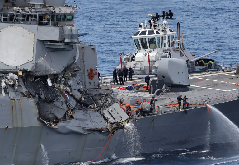 This picture shows damages on the guided missile destroyer USS Fitzgerald off the Shimoda coast after it collided with a Philippine-flagged container ship on June 17, 2017. The US Navy destroyer collided with ACX Crystal cargo ship off the coast of Japan, leaving seven crew members from the American vessel unaccounted for, the Japanese Coast Guard said. / AFP PHOTO / JIJI PRESS / STR / Japan OUTSTR/AFP/Getty Images
