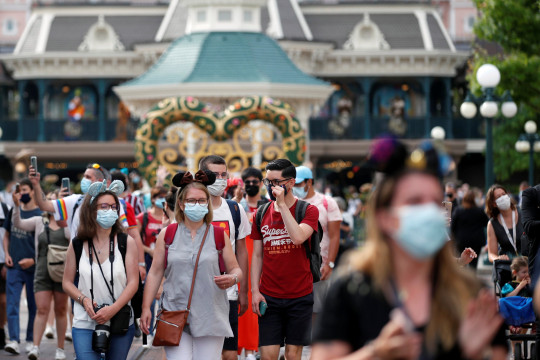 Visitors wear protective face masks at Disneyland Paris as the theme park reopens its doors to the public in Marne-la-Vallee, near Paris, following the coronavirus disease (COVID-19) outbreak in France, June 17, 2021. REUTERS/Gonzalo Fuentes