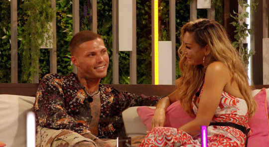 Editorial Use Only. No Merchandising. No Commercial Use. Mandatory Credit: Photo by ITV/REX/Shutterstock (12223091q) Danny Bibby and Andrea-Jane Bunker. 'Love Island' TV show, Series 7, Episode 20, Majorca, Spain - 20 Jul 2021 Snog, Marry Pie prompts words between Kaz and Toby - Girls discuss the ?football Results? - Teddy and Faye go on ?Tour De Faye? date - Islanders have 70s-themed party interrupted by call to fire pit