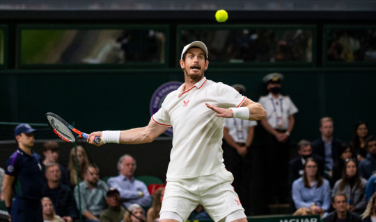 Andy Murray of Great Britain hits a forehand against Oscar Otte of Germany in the second round of the gentlemen's singles during Day Three of The Championships - Wimbledon 2021 at All England Lawn Tennis and Croquet Club on June 30, 2021 in London, England.