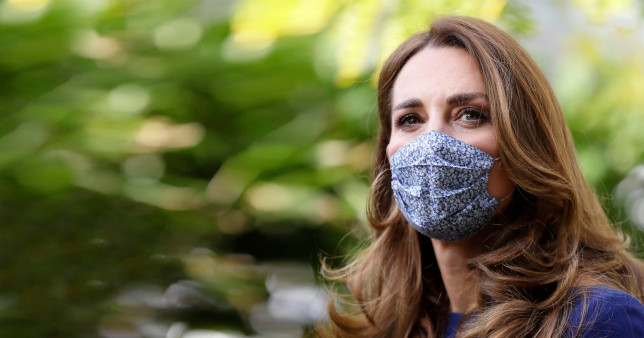 Britain's Kate, the Duchess of Cambridge wearing a face mask to protect against coronavirus, arrives to visit the Institute of Reproductive and Development Biology, at Imperial College in London, Wednesday, Oct. 14, 2020. The Duchess of Cambridge visited the London research centre to hear about the work that national charity Tommy's are doing to reduce rates of miscarriage, stillbirth and premature birth. (AP Photo/Kirsty Wigglesworth, Pool)