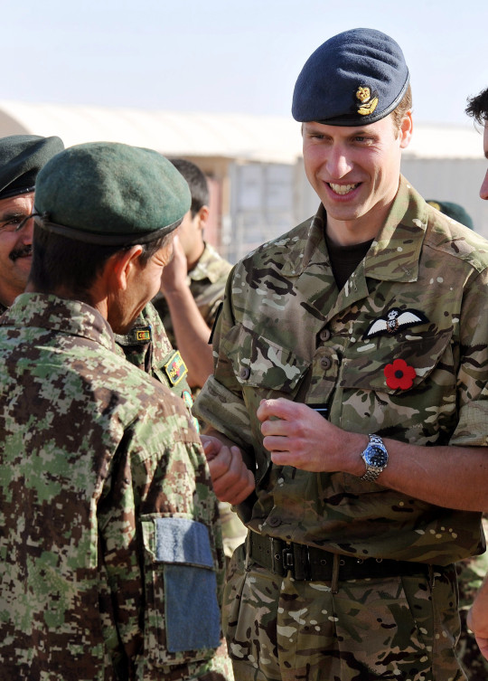 AFGHANISTAN - 14 NOVEMBER 2010: Prince William talks to a member of the Afghan Army, before a Remembrance Day ceremony at Camp Bastion on November 14, 2010 in Afghanistan. Remembrance Sunday tributes were carried out across the nation to pay respects to all who those who lost their lives in current and past conflicts, including the First and Second World Wars. (Photo by John Stillwell - WPA Pool/Getty Images)