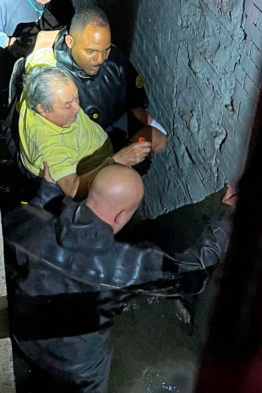 This photo provided by the New York City Police Department shows Special Operations personnel rescuing a man from his flooded basement apartment, in New York , Wednesday, Sept. 1, 2021. The remnants of Hurricane Ida inundated large swaths of the northeastern U.S. with historic and unanticipated fury Wednesday night, killing several people in flooding in New York, New Jersey and Pennsylvania. (New York City Police Department. via AP)