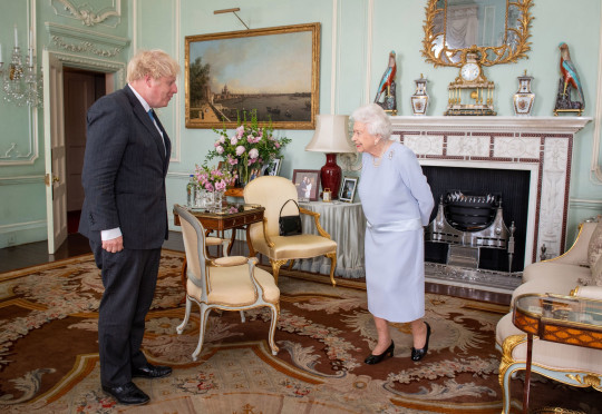 Queen Elizabeth II greets Prime Minister Boris Johnson at an audience at Buckingham Palace, London, the Queen's first in-person weekly audience with the Prime Minister since the start of the coronavirus pandemic. Picture date: Wednesday June 23, 2021. PA Photo. Photo credit should read: Dominic Lipinski/PA Wire