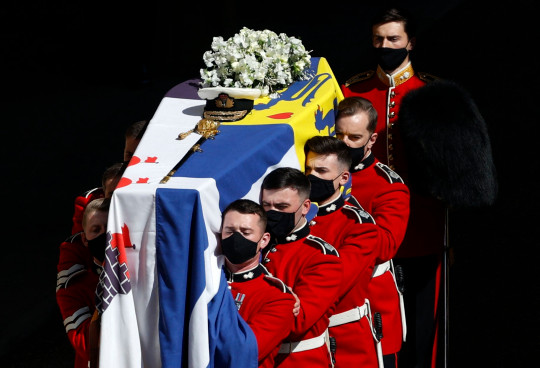 TOPSHOT - The coffin of Britain's Prince Philip, Duke of Edinburgh is laid onto a modified Land Rover Defender in the quadrangle ahead of the ceremonial funeral procession to St George's Chapel in Windsor Castle in Windsor, west of London, on April 17, 2021. - Philip, who was married to Queen Elizabeth II for 73 years, died on April 9 aged 99 just weeks after a month-long stay in hospital for treatment to a heart condition and an infection. (Photo by Adrian DENNIS / POOL / AFP) (Photo by ADRIAN DENNIS/POOL/AFP via Getty Images)