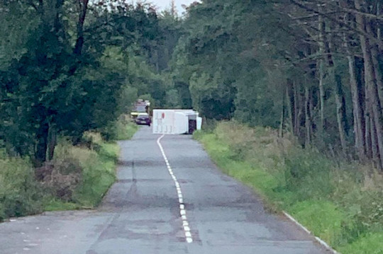 Overturned prison van on Stones Bank Road in Greater Manchester, filming Coronation STreet