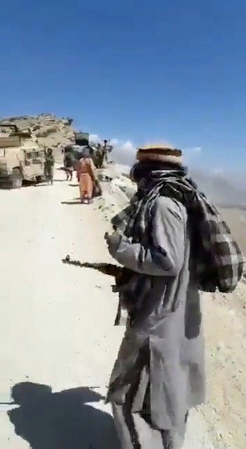 Still frame from an undated video seen by Reuters shows people with guns next to Humvees adorned with the Taliban flag on the mountaintops close to Golbahar, near the southern entrance of Panjshir valley, Afghanistan. Video obtained from social media. ATTENTION EDITORS - THIS IMAGE HAS BEEN SUPPLIED BY A THIRD PARTY. NO RESALES. NO ARCHIVE.
