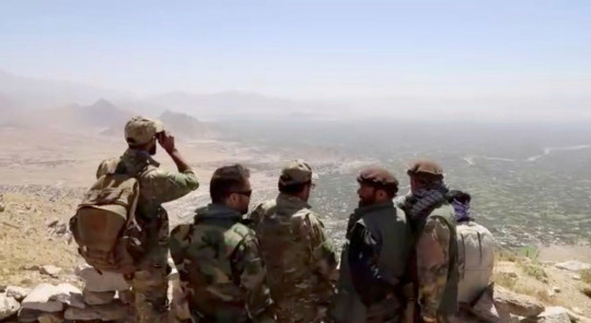 Members of National Resistance Front overlook Golbahar, Kapisa, Afghanistan in this still image obtained from an undated video handout. NATIONAL RESISTANCE FRONT OF AFGHANISTAN HANDOUT/Handout via REUTERS THIS IMAGE HAS BEEN SUPPLIED BY A THIRD PARTY.