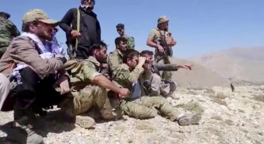 Members of National Resistance Front observe from a hill in Panjshir Valley, Afghanistan in this undated handout picture. NATIONAL RESISTANCE FRONT OF AFGHANISTAN HANDOUT/Handout via REUTERS THIS IMAGE HAS BEEN SUPPLIED BY A THIRD PARTY.