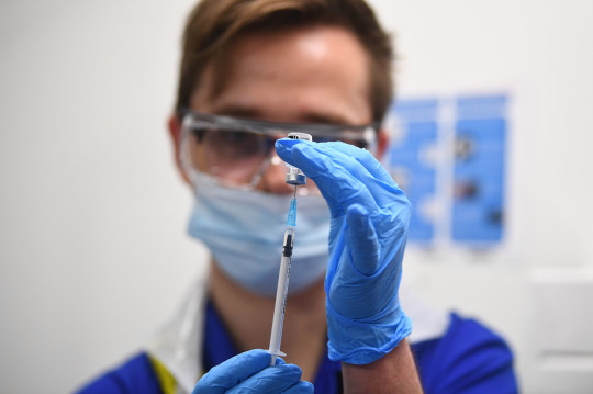 A nurse preparing a vaccine. Unison has warned the Government its 'no jab, no job' policy for care workers could force some care homes to close.