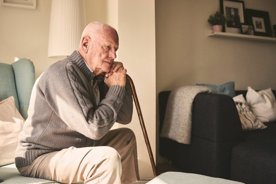 Thoughtful elderly man sitting alone at home with his walking cane. Unison has warned the Government its 'no jab, no job' policy for care workers could force some care homes to close.