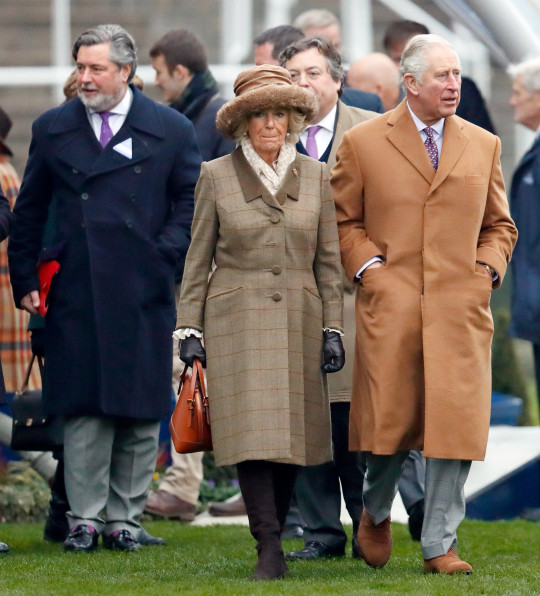 ASCOT, UNITED KINGDOM - NOVEMBER 23: (EMBARGOED FOR PUBLICATION IN UK NEWSPAPERS UNTIL 24 HOURS AFTER CREATE DATE AND TIME) Michael Fawcett, former valet to Prince Charles and current Chief Executive of the Prince's Foundation (L) accompanies Camilla, Duchess of Cornwall and Prince Charles, Prince of Wales as they attend The Prince's Countryside Fund Raceday at Ascot Racecourse on November 23, 2018 in Ascot, England. (Photo by Max Mumby/Indigo/Getty Images)