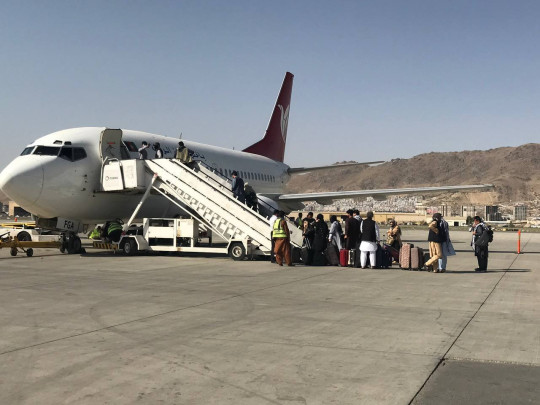KABUL, AFGHANISTAN - SEPTEMBER 04: Passengers board the plane for the first domestic flight from the Taliban controlled Kabul airport on 04, 2021 in Kabul, Afghanistan. (Photo by Bilal Guler/Anadolu Agency via Getty Images)