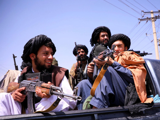 FILE PHOTO: Taliban forces patrol in front of Hamid Karzai International Airport in Kabul, Afghanistan, September 2, 2021. REUTERS/Stringer/File Photo