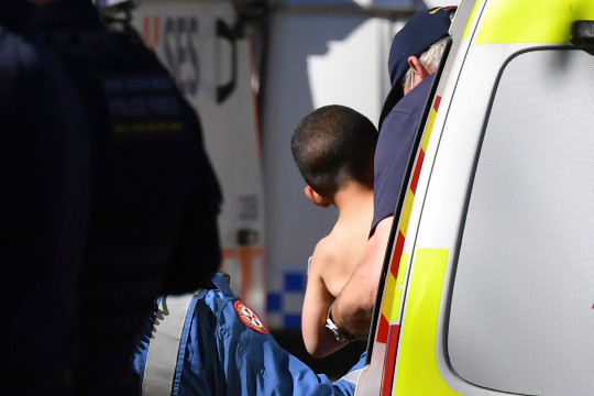 Three-year-old AJ Elfalak is carried by a paramedic into an ambulance after he is found alive on the family property near Putty.