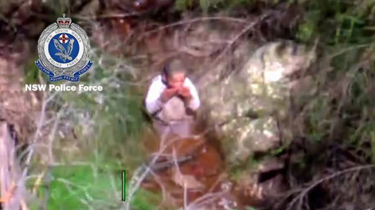 Anthony 'AJ' Elfalak drinks water in a creek bed in Putty, north of Sydney Monday, Sept. 6, 2021.