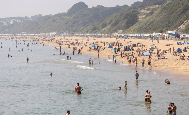 People enjoy the hot weather on Bournemouth beach as the UK is set to have a mini heat wave. Bournemouth, Dorset. 06 September 2021.