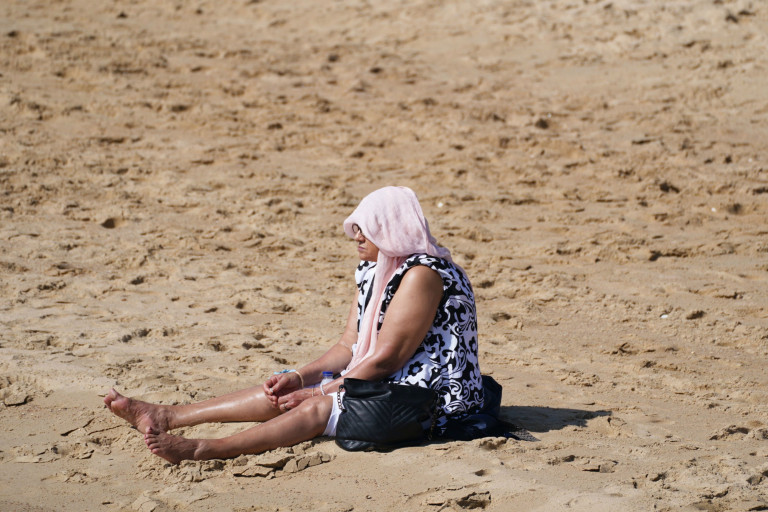 People enjoy the warm weather on Bournemouth Beach in Dorset. Picture date: Monday September 6, 2021. PA Photo. See PA story WEATHER Hot. Photo credit should read: Steve Parsons/PA Wire
