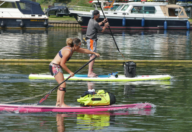 Mandatory Credit: Photo by Geoffrey Swaine/REX/Shutterstock (12419759av) Paddle boarders make the most of the hot snap on The River Thames Seasonal weather, henley on Thames, Oxfordshire, UK - 06 Sep 2021