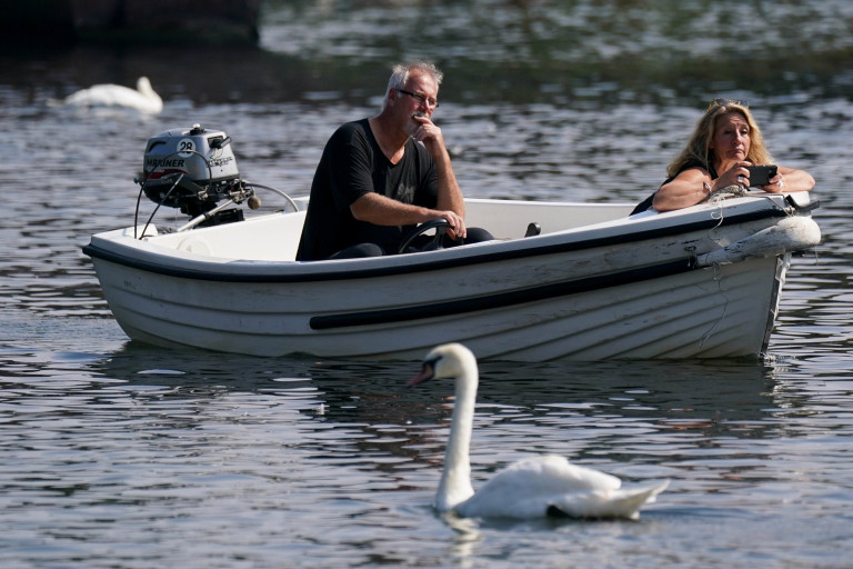 A couple enjoy a boat trip during hot weather in Stratford-upon-Avon, Warwickshire. Picture date: Monday September 6, 2021. PA Photo. See PA story WEATHER Autumn. Photo credit should read: Jacob King/PA Wire