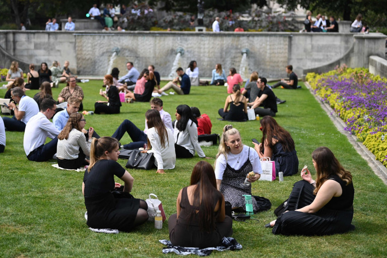 Office workers enjoy the warm weather as they eat lunch outside in London on September 6, 2021. (Photo by DANIEL LEAL-OLIVAS / AFP) (Photo by DANIEL LEAL-OLIVAS/AFP via Getty Images)