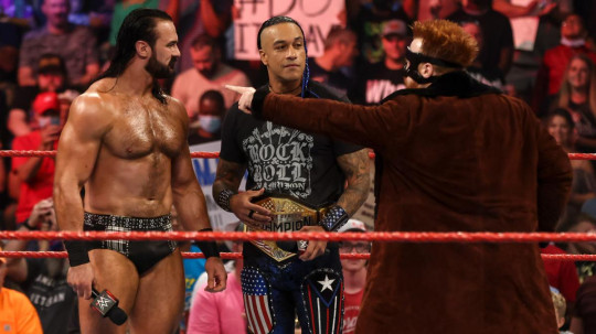 WWE superstar Damian Priest with Drew McIntyre and Sheamus on Raw