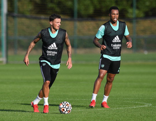 ST ALBANS, ENGLAND - SEPTEMBER 06: (L-R) Ben White and Gabriel of Arsenal during a training session at London Colney on September 06, 2021 in St Albans, England. (Photo by Stuart MacFarlane/Arsenal FC via Getty Images)
