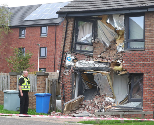 A house on Lancaster Crescent, East Kilbride is destroyed after a van ploughed into it.