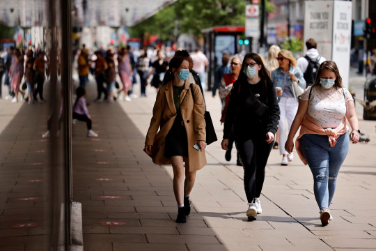 Pedestrians wearing a face mask or covering due to the COVID-19 pandemic, walk along Oxford Street in central London on June 6, 2020. - The Delta variant of the coronavirus, first discovered in India, is estimated to be 40 percent more transmissible than the Alpha variant that caused the last wave of infections in the UK, Britain's health minister said Sunday. (Photo by Tolga Akmen / AFP) (Photo by TOLGA AKMEN/AFP via Getty Images)