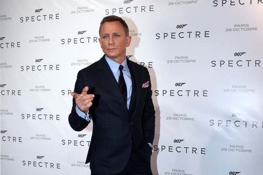 (FILES) In this file photo taken on October 29, 2015 British actor Daniel Craig poses during the French premiere of the new James Bond film 'Spectre' in Paris - New James Bond footage from historic Hollywood studio MGM shook and stirred the movie theater industry's CinemaCon summit in Las Vegas August 24, 2021, as executives struck a defiant note about the future of the big screen. (Photo by MIGUEL MEDINA / AFP) (Photo by MIGUEL MEDINA/AFP via Getty Images)