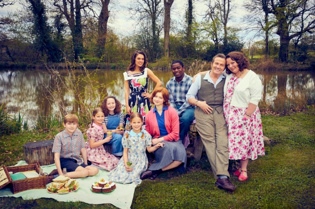 This image and the information contained herein is strictly embargoed until 00.01 Thursday 30th September 2021 From Objective Fiction / Genial Productions The Larkins on ITV and ITV Hub Pictured: Montgomery Larkin [Liam Middleton], Petunia Larkin [Rosie Coleman],Victoria Larkin [Lola Shepelev], Zinnia Larkin [Davina Coleman], Mariette [Sabrina Bartlett], Primrose Larkin [Lydia Page], Charley [Tok Stephen], Pop Larkin [Bradley Walsh] and Ma Larkin [Joanna Scanlan]. This photograph is (C) ITV Plc / Objective Fiction / Genial Productions and can only be reproduced for editorial purposes directly in connection with the programme or event mentioned above, or ITV plc. Once made available by ITV plc Picture Desk, this photograph can be reproduced once only up until the transmission [TX] date and no reproduction fee will be charged. Any subsequent usage may incur a fee. This photograph must not be manipulated [excluding basic cropping] in a manner which alters the visual appearance of the person photographed deemed detrimental or inappropriate by ITV plc Picture Desk. This photograph must not be syndicated to any other company, publication or website, or permanently archived, without the express written permission of ITV Picture Desk. Full Terms and conditions are available on the website www.itv.com/presscentre/itvpictures/terms For further information please contact: james.hilder@itv.com / 0207 157 3052n