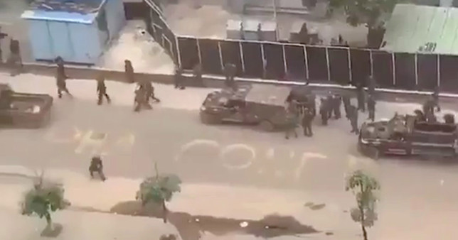 Heavy gunfire could be heard in unauthenticated footage shot near the presidential palace