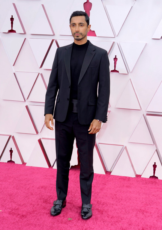 epa09160063 Riz Ahmed arrives for the 93rd annual Academy Awards ceremony at Union Station in Los Angeles, California, USA, 25 April 2021. The Oscars are presented for outstanding individual or collective efforts in filmmaking in 24 categories. The Oscars happen two months later than originally planned, due to the impact of the coronavirus COVID-19 pandemic on cinema. EPA/Chris Pizzello / POOL *** Local Caption *** 55864152